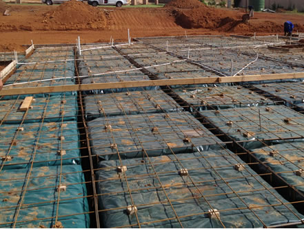 Reinforced raft foundation