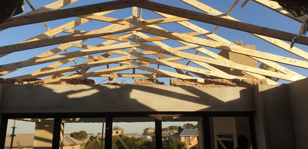 ROOF EXTENSION WITH EXPOSED SCISSOR TRUSSES